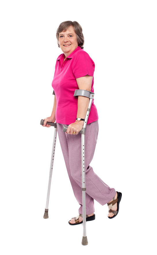 Smiling senior woman walking with crutches. All on white background