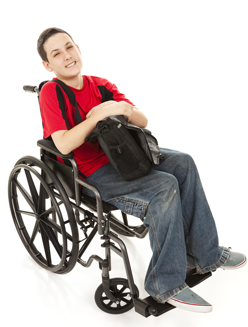 Disabled teen boy in his wheelchair with his backpack.  Full body isolted on white.