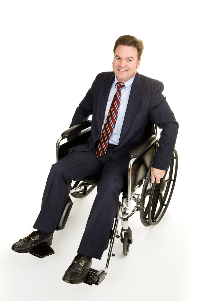 Handsome forty year old businessman in a wheelchair.  Full body isolated on white.