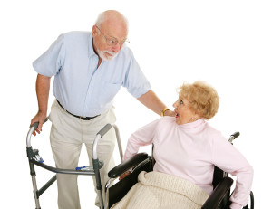 Senior man and woman in a nursing home exchanging gossip.  Isolated on white.